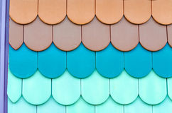 Close-up of colorful tiles. Close up of red, black roof tiles and pans, texture Royalty Free Stock Photos
