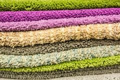 Close up of colorful towels in supermarket. Closeup of colorful towels lying on shelf in store Stock Photo