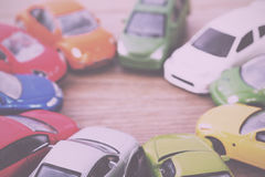 Close up of colorful toy cars. Shallow DOF. Vintage Retro Filter Royalty Free Stock Photos