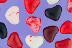 Close Up of Colorful Valentine Candies on Purple Royalty Free Stock Image