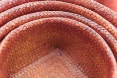 Close up colorful woven pattern on the woman handbag. Handmade natural organic tan rattan handbag for background Stock Photo