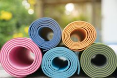 Close up of colorful yoga mat on the table stock image