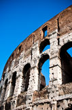 Close-up of the Colosseum in rome. Colosseum in Rome with brigth blue sky showing the arches Royalty Free Stock Images