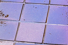 Close up Colouful Reflections and Grunge on Wet Tiles Royalty Free Stock Image