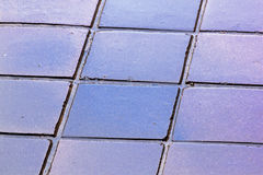 Close up Colouful Reflections and Grunge on Wet Tiles Stock Image