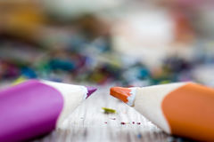 Close up on colour pencil. Closeup look on colorful pencil and shreds Stock Photos