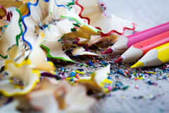 Close up on colour pencil. Closeup look on colorful pencil and shreds Stock Images