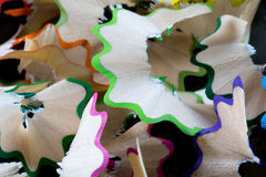 Close up on colour pencil. Closeup look on colorful pencil and shreds Royalty Free Stock Photos