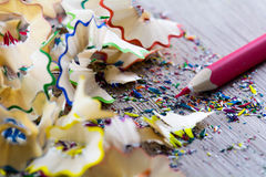 Close up on colour pencil. Closeup look on colorful pencil and shreds on wood back ground Stock Image
