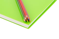 Close up colour pencil and notebook spiral bound on white background. Close up colour pencil and notebook spiral bound and white background royalty free stock photos