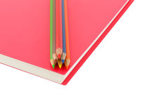 Close up colour pencil and notebook spiral bound on white background. Close up colour pencil and notebook spiral bound and white background stock photo