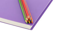 Close up colour pencil and notebook spiral bound on white background. Close up colour pencil and notebook spiral bound and white background stock images