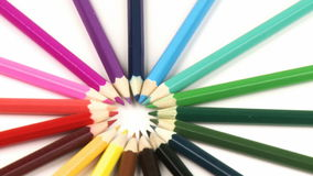 Close up of colour pencils in a circle turning against white stock video