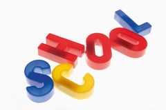 Close up of colourful plastic letters reading school against whi Royalty Free Stock Images