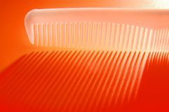 Close up of a comb. On red Royalty Free Stock Photo
