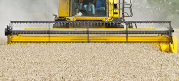 Close up of a combine harvester at work Stock Photography