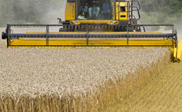 Close up of Combine harvester at work Stock Photography