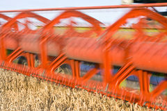 Close up of combine harvesting wheat Royalty Free Stock Photos