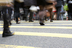 Close Up Of Commuters Feet Crossing Busy Street. Close Up Of Commuters Feet Crossing Busy Hong Kong Street Stock Photos