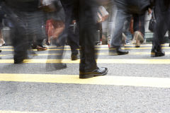 Close Up Of Commuters Feet Crossing Busy Street. Close Up Of Commuters Feet Crossing Busy Hong Kong Street Royalty Free Stock Photo