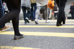 Close Up Of Commuters Feet Crossing Busy Street Royalty Free Stock Photography