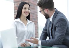 Close-up of company employees communicating in the office. Photo has a blank space for text Stock Photography