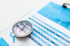Close up of compass on financial report document Stock Image