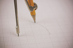Close up of a compass on graph paper Stock Photos