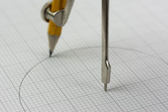 Close up of a compass on graph paper Royalty Free Stock Photography