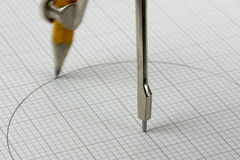 Close up of a compass on graph paper Stock Images