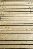 Close up of composite decking. Wood planks. Kiln dried wooden lumber texture background. Stock Image