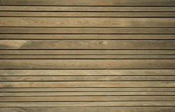Close up of composite decking. Wood planks. Kiln dried wooden lumber texture background. Royalty Free Stock Images