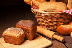 Close up of composition with bread in wicker Royalty Free Stock Photography