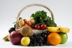 Close-up composition with vegetables and fruit in wicker basket Royalty Free Stock Image