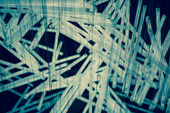 Close up of a composition of white and blue light tubes hanging Royalty Free Stock Image