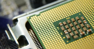 Close-up of computer chip. On motherboard stock video footage