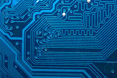 Close up of computer circuit board in blue. Macro Royalty Free Stock Photography