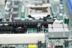 Close-up of computer motherboard component. The motherboard is a sheet of plastic that holds all the circuitry to connect the various components of a computer Royalty Free Stock Photos