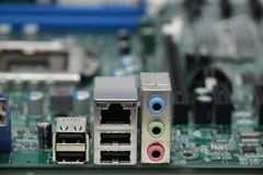 Close-up of computer motherboard component. The motherboard is a sheet of plastic that holds all the circuitry to connect the various components of a computer Royalty Free Stock Photo