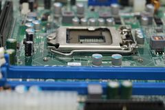Close-up of computer motherboard component. The motherboard is a sheet of plastic that holds all the circuitry to connect the various components of a computer Stock Photo