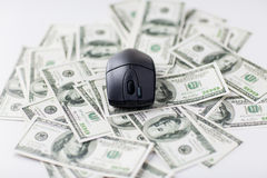 Close up of computer mouse and dollar cash money Stock Photography
