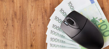 Close up of computer mouse and euro money Royalty Free Stock Photo