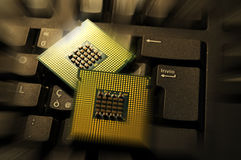 Close Up of Computer Processor CPU on a keyboard. background. tecnology concept. Royalty Free Stock Images