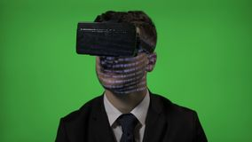 Close up of a computer programmer man dressed in suit coding on vr augmented reality glasses on green screen -. Close up of a computer programmer man dressed in stock video