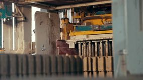 Close-up of a concrete road curbs at the factory for the production of cement products, paving slabs, construction stock video