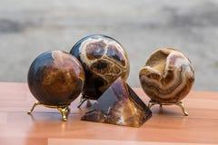 Close up concretion stone figures souvenirs. Closeup of brown concretion stone figures souvenirs stock image