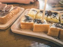 Close up condensed milk toast and chocolate topping Royalty Free Stock Photos