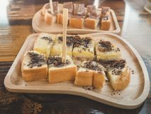 Close up condensed milk toast and chocolate topping Stock Images