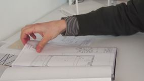 Close up of confident architect male working with architectural plan. Close up of confident architect male in casual wear working with architectural plan stock footage