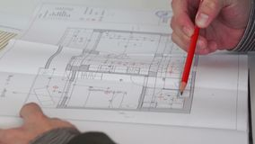 Close up of confident architect male working with architectural plan